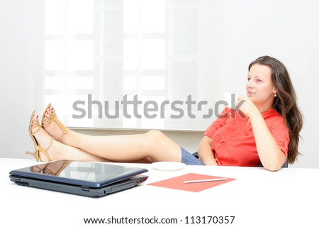 Real attractive businesswoman having a coffee break in her office