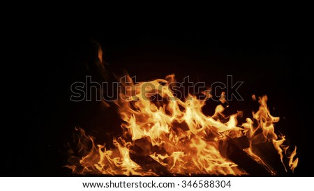 Real big shot fire with particles on black background, perfect for digital composition. - stock photo