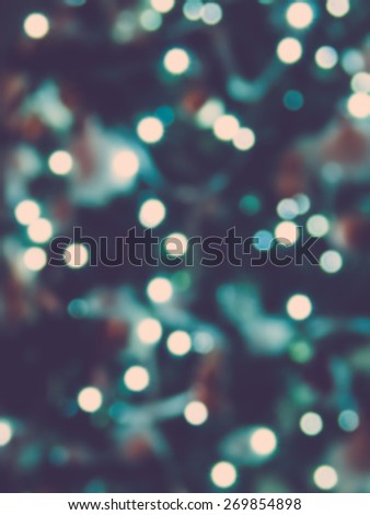 Real bokeh from christmas tree lights, faded look filter - stock photo