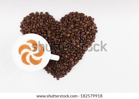 Real capuccino decorated with cinnamon - stock photo