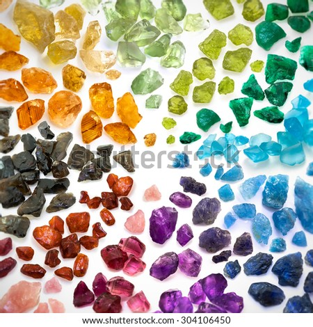 Real colorful gemstones background. Square shaped image with blurred and darkened edges. - stock photo