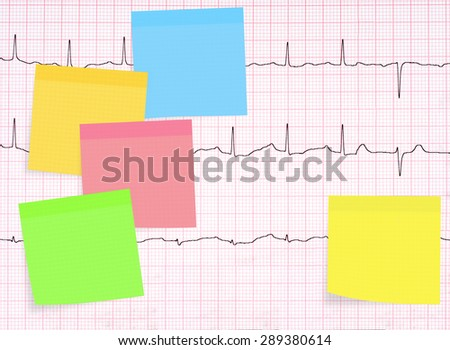 Real ECG, EKG, electrocardiogram behind assorted postits for your healthy heart messages. - stock photo