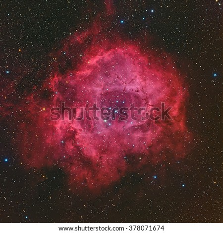Real emission nebula named Rosette nebula taken with CCD through telescope - stock photo