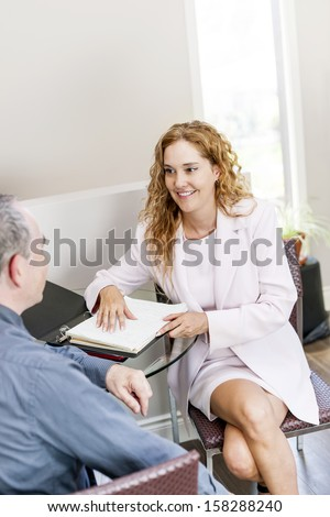 Real estate agent meeting with client in business office - stock photo