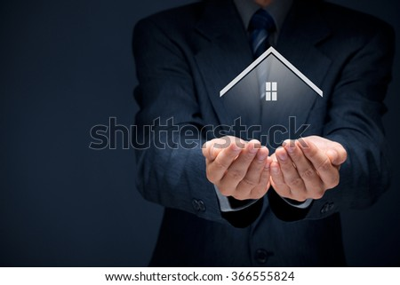 Real estate agent offer house. Property insurance and security concept. Big symbol of the house. - stock photo
