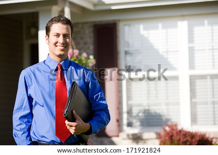 Real Estate: Agent Ready To Sell Home - stock photo
