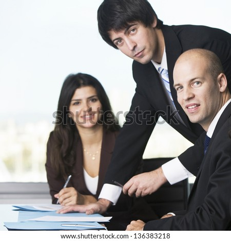 Real Estate Agents smiling - stock photo
