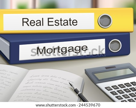 real estate and mortgage binders isolated on the office table - stock photo