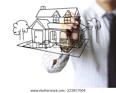 Real estate, Business man drawing a house  - stock photo