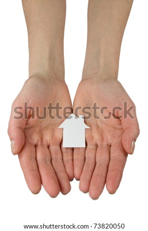 Real estate concept. hands holding a paper house icon - stock photo