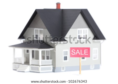 Real estate concept - house architectural model with sale sign, isolated