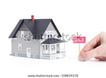 Real estate concept - household architectural model with sale sign, isolated - stock photo