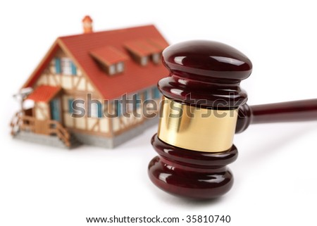 real estate concept,isolated on white background, selective focus on gavel - stock photo
