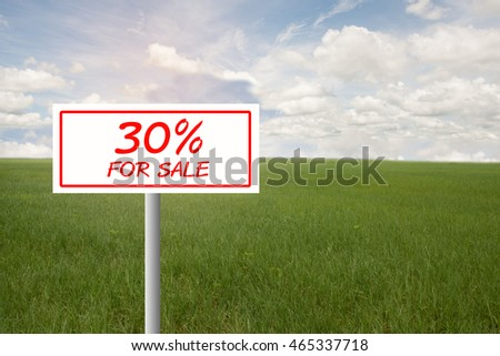 Real estate concept. Land For Sale signboard on the meadow under blue sky
