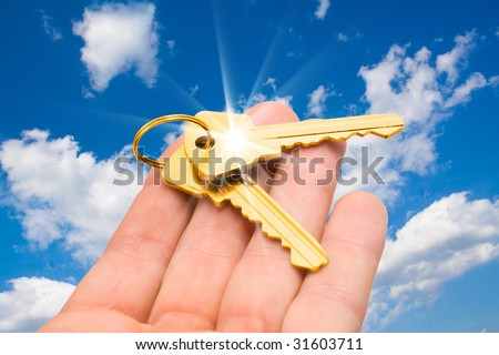 real estate concept. two keys on a palm - stock photo
