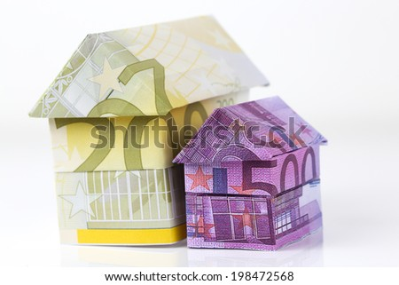 Real estate concept with Euro bank notes House