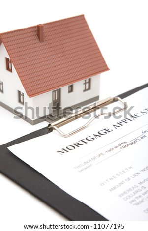 real estate concept with mortgage application form on white