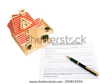 real estate contact and an architectural model on white with clipping path - stock photo