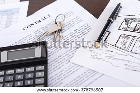 Real estate contract with keys, calculator and pen (random english dummy text used)