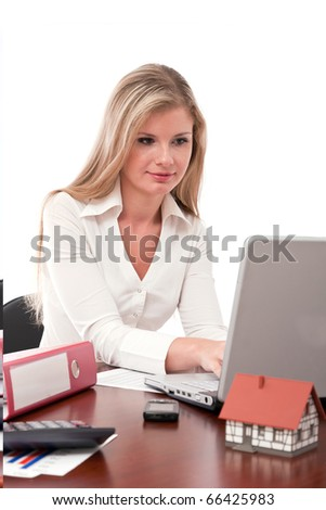 Real estate executive working on laptop - stock photo