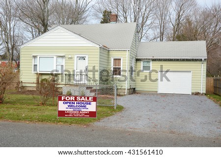 Real estate for sale open house (another success let us help you buy sell your  next home)  welcome sign suburban bungalow house chain link fence residential neighborhood overcast sky USA - stock photo