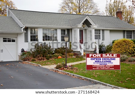 Real estate for sale open house welcome sign Beautiful Gray Ranch home Bay Window Autumn Overcast Day Residential neighborhood USA