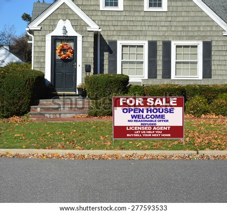 Real estate for sale open house welcome sign Close up of Beautiful Home Leaf wreath Sunny autumn day residential neighborhood USA