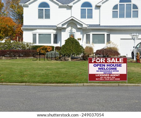 Real estate for sale open house welcome sign closeup of suburban mcmansion autumn day residential neighborhood USA