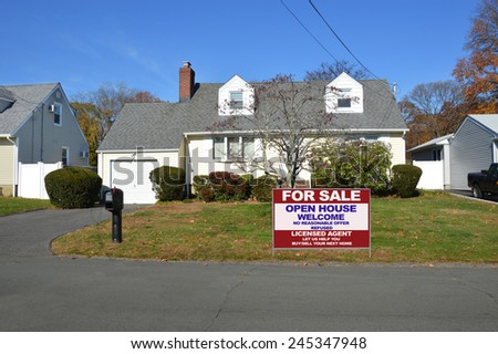 Real Estate for sale open house welcome sign Suburban Cape Cod home autumn day residential neighborhood Sunny Clear Blue Sky Day USA