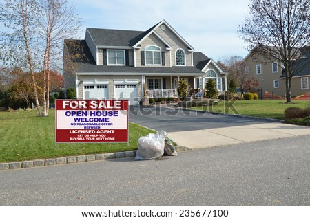Real Estate for sale open house welcome sign Suburban McMansion home autumn day residential neighborhood USA - stock photo