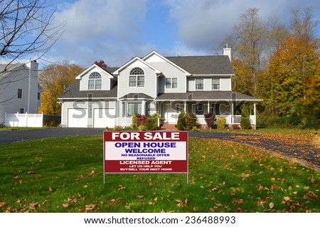 Real Estate for sale open house welcome sign suburban McMansion home autumn day residential neighborhood USA blue sky clouds