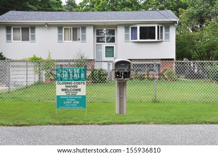 Real Estate Home for Sale Sign Lost Job No Closing Costs front yard lawn of High Ranch style home curbside Mailbox USA
