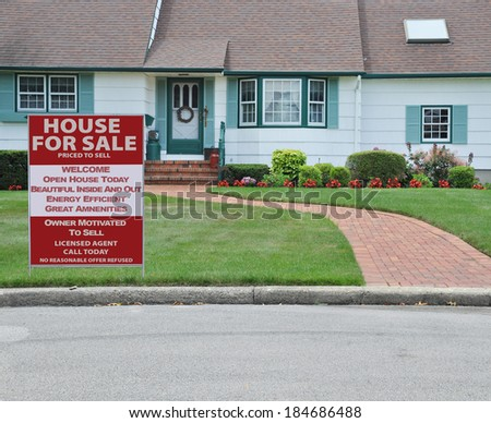 Real Estate House for Sale sign Close Up of Suburban Home House Front Landscaped Brick Walkway Curb Residential neighborhood USA - stock photo