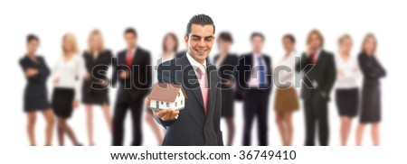 real estate in business concept with a house and business people - stock photo