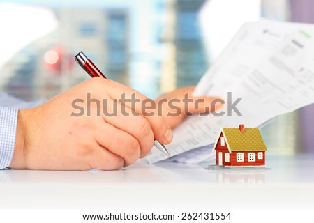 Real estate investment. Signing the loan papers. - stock photo