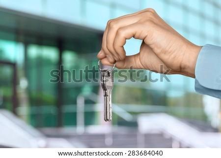 Real Estate, Key, Human Hand. - stock photo