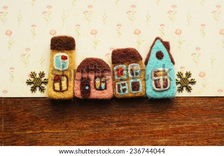 real estate: little houses and decorative snowflakes - stock photo