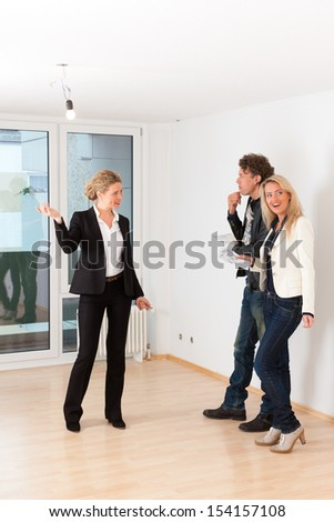 Real estate market - young couple looking for real estate to rent or buy an apartment - stock photo