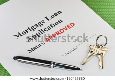 Real Estate Mortgage Approved Loan Document With Pen And House Keys - stock photo