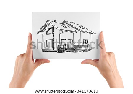 Real estate offer. Female hands holding the house picture - stock photo