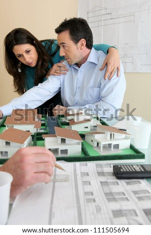 real-estate promoter and couple - stock photo