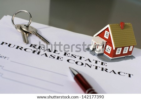 Real estate purchase contract on a table.