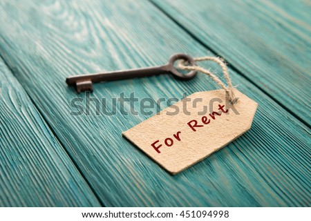real estate rent concept - old key with tag - stock photo