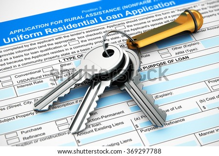 Real estate rental and home ownership business financial concept: macro view of bunch of shiny metal house keys with keychain on mortgage or loan application form document with selective focus effect - stock photo