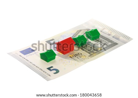 Real estate replica houses on euro banknotes - stock photo