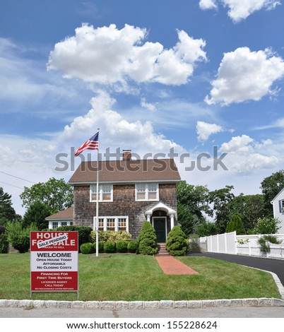 Real Estate Sale Pending House For Sale Sign on Front Yard Lawn of Gable Style Suburban Home in Residential Neighborhood Sunny Blue Sky Clouds Daytime USA - stock photo