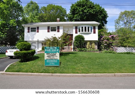 Real Estate Sale Pending Under Contract For Sale Sign Suburban Home High Ranch Style Sunny Residential Neighborhood Blue Sky Day USA - stock photo