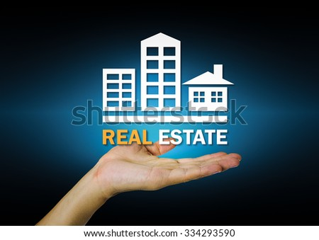 Real estate sign on hand with dark background. - stock photo