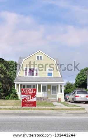 Real Estate Sold (another success let us help you buy sell your next home) Sale Sign Suburban Gambrel Style Home Residential neighborhood usa blue sky clouds