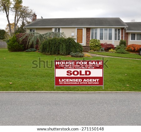 Real estate sold (another success let us help you buy sell your next home) sign Suburban Ranch Home Landscaped Residential neighborhood USA Overcast Sky - stock photo